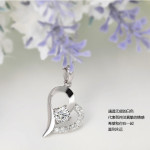 Silver heart-shaped necklace with a gold chain